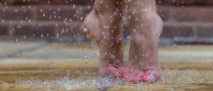 Naked feet dancing in the rain
